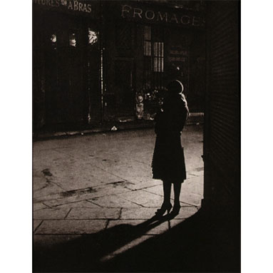 Brassai_Prostitute_at_angle_of_Rue_De_La_Reynie_and_Rue_Quincampoix_1933